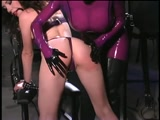 Purple Latex Dominatrix Pegging her lover