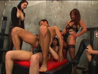 Women strap-on gangbang a man