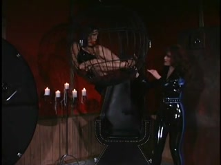 Latex Mistress and her caged rubber slave girl