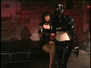 Latex goddess uses dildo slave