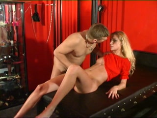 Female slave in a cage restraints