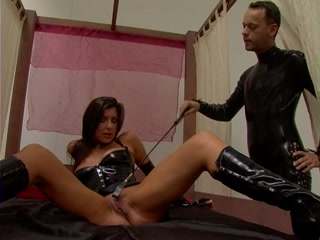 Female slave whipped and anal plugged