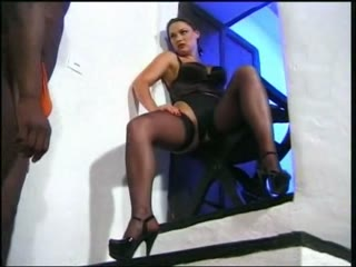 Ebony slave licks a woman in stockings