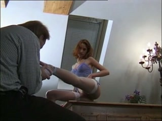 Woman gets feet licked by male sex slave