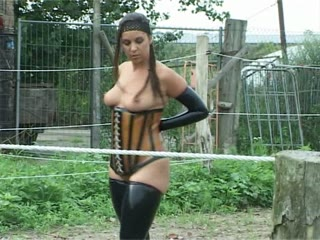 Lesbians in Latex and Rubber playing outdoors