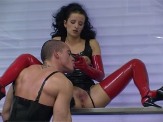 Fetish couple have sex in rubber outfits